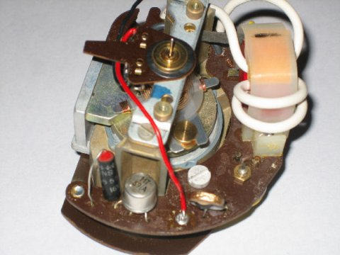 the photo below show the original board  note the white wire looping  through the transformer  this is the pickup